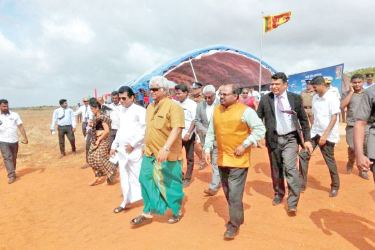 Minister Arjuna Ranatunga and Transport State Minister Ashok Abeysinghe and other officials at Palali.