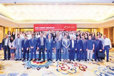 Posing for a group photograph with Media representatives from China