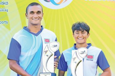 Best swimmers D. A. Peiris and Ramudi N. Samarakoon with their trophies.