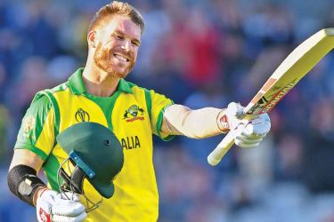 Australia's David Warner celebrates after scoring a century (100 runs) during the 2019 Cricket World Cup group stage match between Australia and South Africa at Old Trafford in Manchester, northwest England, on July 6, 2019. AFP