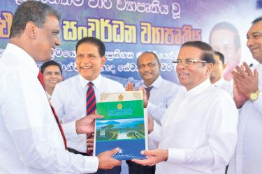 President Maithripala Sirisena yesterday felicitated 400 individuals who contributed to make the Moragahakanda-Kaluganga Multipurpose Development Project a success. Here, President Sirisena presenting a certificate of appreciation to one of the officials who contributed to the project's success at a ceremony held at Moragahakanda reservoir premises. Picture by Sudath Silva
