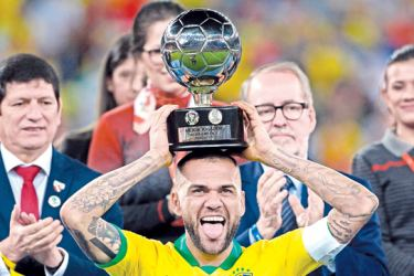 Brazil's Dani Alves poses with his trophy for Best Player of the Copa America after defeating Peru in the final match of the football tournament at Maracana Stadium in Rio de Janeiro, Brazil, on July 7, 2019. AFP