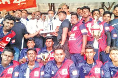 Champion trophy handing over by the Director of Education Eastern Province M.K.M. Mansoor.  Rev.Fr. Paul Satkunanayagam, Batticaloa District Sports Officer V.Easwaran, Hutch Telecom Chief Executive Officer Thirukkumaran Nadaraja and General Manager Manoj Moses are also present.