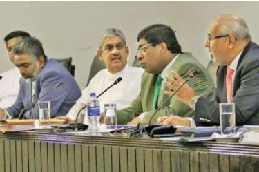 SLFP General Secretary MP Dayasiri Jayasekara giving evidence before the Parliament Select Committee (PSC) to probe the Easter Sunday terrorist attacks chaired by Deputy Speaker Ananda Kumarasiri at the Parliament complex yesterday. PSC members Minister Ravi Karunanayake, and MPs Rauff Hakeem, Field Marshal Sarath Fonseka, Prof. Ashu Marasinghe, Dr. Jayampathy Wickramaratne, M.A. Sumanthiran and Dr Nalinda Jayatissa were present. Pictures by Rukmal Gamage