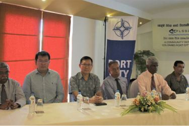 Seated left to right: W. A. D. D. Wijesooriya- team leader Port City Environment Management Plan (EMP), Joe Zhao, Construction Manager, CHEC Port City Colombo (Pvt) Ltd, Simon Tham, Assistant General Manager, CHEC Port City Colombo (Pvt) Ltd, G. Piyasena, President, Fishermen Livelihood Support Society, H. S. G. Fernando, Operation Manager, Fishermen Livelihood Support Society, Ranjith Bandara, Assistant Director, Negombo Fishery Division, Department of Fisheries.