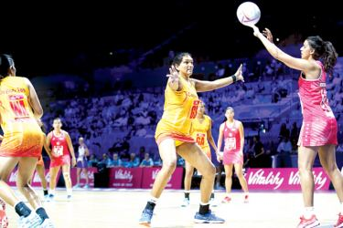 Tharjini Sivalingam defends for Sri Lanka during their Netball World Cup match against Singapore.