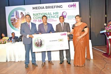 Dhammika Fernando – President CIPM SL, accepting the Co Sponsorship from Bank of Ceylon