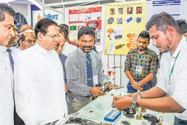 President Maithripala Sirisena at the Shilpa Sena exhibition yesterday. Minister Sujeeva Senasinghe looks on. Picture by President's Media Division.