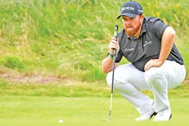Ireland's Shane Lowry prepares to putt at the 18th green during the third round of the British Open golf Championships at Royal Portrush golf club in Northern Ireland on Saturday. – AFP