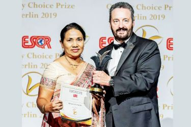 Vidya Dias, Deputy General Manager-Quality Management of SLT accepting the award