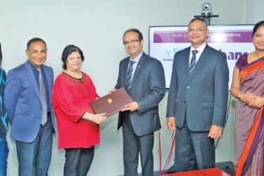 Officials exchanging the MoU