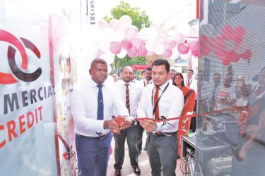 Officials opening the relocated branch.
