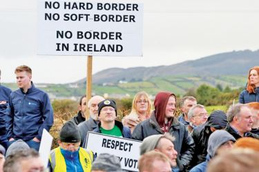 """The group """"Border Communities Against Brexit"""" holds an anti-Brexit demonstration near the border between Northern Ireland and Ireland in Newry, Northern Ireland. - AFP"""