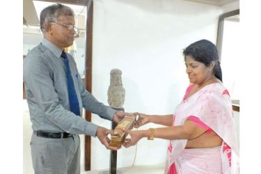 Sri Jayewardenepura University Department of History & Archaeology Curator N.M.P. Neththasinghe completed the restoration of a Palm Leaf Manuscript and returned it to Director - Legal & Secretarial of the MMBL – Pathfinder Group K.D.Liyanage.