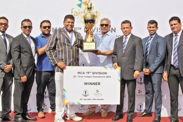 Fairfirst Insurance Captain, Lakshan Perera (4th from left) receiving the Fairfirst Insurance Trophy from the chief guest, Managing Director and CEO, Sanjeeve Jha (4th from right). Others in the picture (from L): Sasith Bambaradeniya (Head of Marketing and Digital Solutions), Sanjay Siriwardena (Head of Sales), Ravi Shanker (Head of Finance) - all from Fairfirst Insurance, Roshan Iddamalgoda (President), Tarindra Kaluperuma (Asst. Treasurer and Secretary - Tournament Committee) and Duminda Pinto (Executive