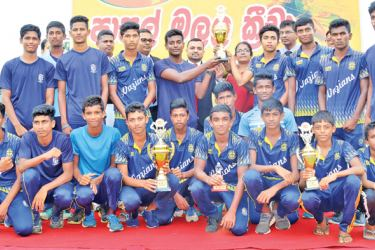 Boys' overall champions of the North-Western Provincial School Games, St. Joseph Vaz College Wennappuwa with the Championship trophy and guests.