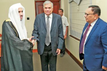 Prime Minister Ranil Wickremesinghe and Postal Services and Muslim Religious Affairs Minister M.H.A. Haleem with Muslim World League Secretary General Dr. Mohammad Bin Abdulakarim Alissa, at Temple Trees yesterday. Picture courtesy Prime Minister's Media Unit