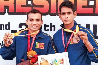 A.M.G.I. Bandara (left) and R.M.P. Dharmasena displaying the bronze medals won in Indonesia.