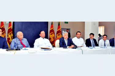 Prime Minister Ranil Wickremesinghe, Tourism Minister John Amaratunge, State Minister of Tourism Development, Ranjith Aluvihare and other officials at Temple Trees yesterday. Pictre by Gayan Pushpika