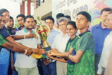Horana DS players receiving the Overall Championship Cup from Kalutara District Secretary and GA U D C Jayalal and other NYSC officers, at the Bandaragama Stadium.  Pic by Kalutara Central Special Corr. - H L Sunil Shantha
