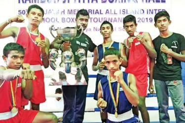 T.B. Jayah memorial boxing meet champions Narandeniya National School, Kamburupitiya boxing team with coach Pradeep Jayasinghe.