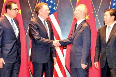 United States Trade Representative Robert Lighthizer (centre-left) shakes hands with China's Vice Premier Liu He (centre-right) as U.S. Treasury Secretary Steven Mnuchin (L) and China's Commerce Minister Zhong Shan (R) look on at the Xijiao Conference Centre in Shanghai on July 31.