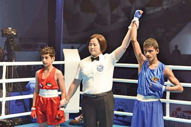 Ashen Shreemal Premathilaka being declared the winner in his preliminary bout against Kuwait's Omar Alotaibi.