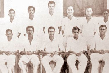 The Royal College first eleven cricket team of 1956. Selvi is seated on extreme left front row and Mike Wille is standing third from left back row.