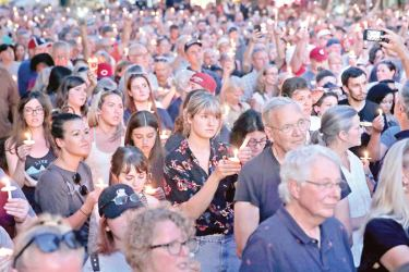 Mourners attend a memorial service in the Oregon District to recognize the victims of an early-morning mass shooting in the popular nightspot onSunday in Dayton, Ohio. - AFP