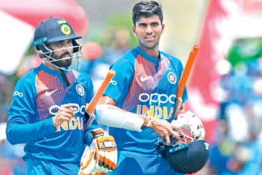 Ravindra Jadeja (L) and Washington Sundar (R) of India walks off the field after wining the 1st T20i match between West Indies and India at Central Broward Regional Park Stadium in Fort Lauderdale, Florida, on August 3, 2019. AFP