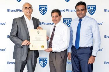 Ruchi Gunawardene, Managing Director, Brand Finance Lanka presenting the certificate endorsing PLC as Sri Lanka's highest ranked and most loved brand in the financial services sector to Sabry Ibrahim, CEO/General Manager of PLC. Also in the picture is Laksanda Gunawardene, Deputy General Manager (Marketing)
