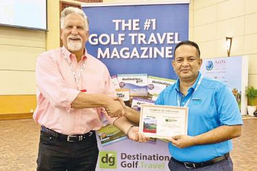 "Asela Wavita, General Manager of The Victoria Golf & Country Resort, being presented the certificate for the ""Most Memorable Golf Course in Asia 2019"" by  Sam Sokocius, Member of the Panel of Judges and Golf Travel Writer of Destination Golf."