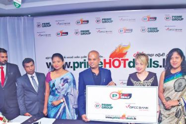 B, Premalal Chairman - Prime Group presenting the ceremonial and  symbolic token of partnership to Gillian Edwards Senior Vice  President, Consumer Banking - DFCC.  Dineth Silva (Manager - Digital Media of Prime Group, Nandana  Edirisinghe (Company Secretary of Prime Group), Sandamini Perera  (Deputy Chairperson of Prime Group), Brahmanage Premalal (Chairman  of Prime Group), Gillian Edwards (Senior Vice President , Consumer  Banking of DFCC), Samanthri Kariyawasam (Vice President, General  Legal of DFCC)