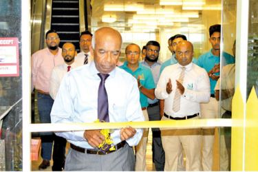 St. Anthony's Hardware Chairman, S.R. Gnanam opens the 'HOMEMART mini' at Orion City.