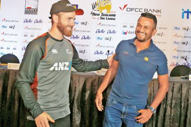 Rival captains Kane Williamson and Dimuth Karunaratne in all smiles at the end of the media conference held at Taj Samudra yesterday. Picture by Rukmal Gamage