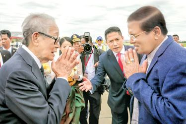 President Maithripala Sirisena arrived in Cambodia yesterday on a four-day state visit. President Sirisena was warmly welcomed at the Phnom Penh International Airport by Samdech Chaufea Veang Kong Sam Ol, Deputy Prime Minister and Minister of the Royal Palace and Khieu Kanharith, Minister of Information and Minister-in-attendance. Picture by Sudath Silva