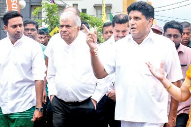 Political differences set aside, Prime Minister Ranil Wickremesinghe and Housing Minister Sajith Premadasa are seen together along with NYSC Chairman Erandika Welianga in animated conversation while touring a newly built housing complex they had just inaugurated.  Picture by Hirantha Gunatilleke