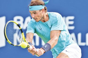 Rafael Nadal of Spain hits a return against Daniil Medvedev of Russia during the mens singles final on day 10 of the Rogers Cup at IGA Stadium on August 11, 2019 in Montreal.
