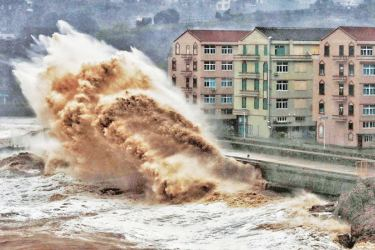 Waves hit a sea wall in front of buildings in Taizhou, China's eastern Zhejiang province on Saturday.