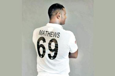 Angelo Mathews  displays the new  Sri Lanka Test jersey.