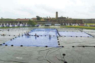 The Galle International Cricket Stadium under covers yesterday following the heavy rains. – AFP