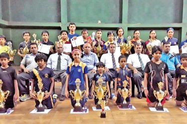 The winners of the Western Province Open and junior ranking tournament with their trophies. The President of St John's Nugegoda OBA Malins Alwis, Sunimal Rupasinghe, distinguished St John's Old Boy and Masters Athletic  Association Secretary, National champion Rohan Sirisena and the other special guests are also in the picture.