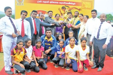 Overall winner of the Uva Provincial School Games, Welimada Educational Zone team with Major Sudarshan Denipitiya (Leader of the House, Uva Provincial Council), W.D. Priyantha Amarasiri (Mayor of Badulla), Sandya Ambanwella (Education Secretary, Uva Province), C. Jayalath (Secretary to the Chief Minister, Uva Province), R.M.P. Ratnayaka (Education Director, Uva Provincial Department of Education), Channa Karunasena (Assistant Director, Uva Provincial Department of Education) and Sumith Nissanaka (Category M