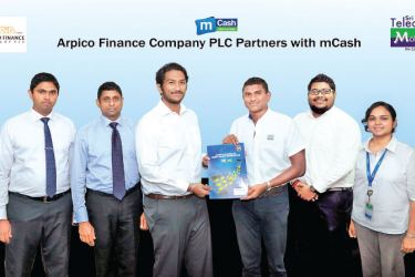Exchanging the partnership agreement between Mobitel Senior General Manager Marketing Isuru Dissanayaka and Arpico Finance Company PLC Managing Director Shanil Dayawansa.  Arpico Finance Company PLC Head of IT Suneth Piumal, Arpico Finance Company PLC Chief Executive Officer Chandrin Fernando, Mobitel Assistant Manager Mobile Financial Services Gayan Kalugamage and Mobitel Product Executive, Mobile Financial Services Hiranya Karunarathne  look on.