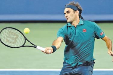 Roger Federer of Switzerland returns a shot to Juan Ignacio Londero of Argentina during the Western & Southern Open at Lindner Family Tennis Center on Tuesday in Mason, Ohio. - AFP