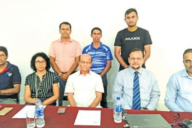 Officials posed for a photograph during the Umpires Accreditation/Appraisal Test and refresher programme, hosted by Sri Lanka Badminton at the Sri Lanka Foundation Institute in Colombo 7. Seated from left: Sanjeewa Wijesekara, Lakshmi Liyanage, Ajith Wijesinghe, Sri Lanka Badminton Vice President Parakrama Basnayake and BWF Referee Rohana de Silva. Back row from left: Upul Gamlath, Kasun Kalhara, Chathuranga Wishwanath.