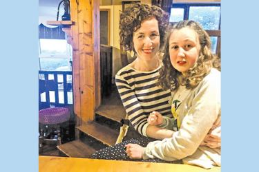 This file handout of a recent picture released by the Quoirin family on August 5, 2019 shows Nora Quiorin, a 15-year-old Franco-Irish teenager who went missing from a Malaysian rainforest resort, posing with her mother Meabh. - AFP