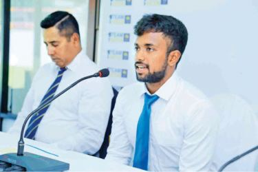 Sri Lanka Emerging team skipper Charith Asalanka addresses the press conference at SLC headquarters yesterday. Head coach Chaminda Vaas is also present. The team will be managed by Chaminda Mendis.