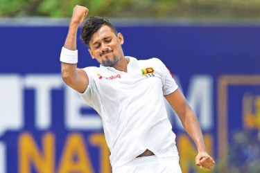 Sri Lanka fast bowler Suranga Lakmal celebrates a wicket on his way to a four-wicket haul on the second day. - AFP