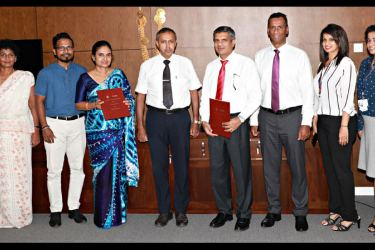 Teejay Lanka CEO Shrihan Perera and Prof. K. K. C. K. Perera, Vice Chancellor of the University of Moratuwa (4th and 5th from right respectively) at the exchange of the MoU. Others in the picture are (from left) the University's Registrar W. M. D. P. M. Hulugalla, Lecturer at the Department of Textile and Clothing Technology M. G. C. C. Dharmakeerthi, the Head of the Department of Textile and Clothing Technology Prof.  U. G. S. Wijayapala and Teejay Lanka's Deputy CEO Pubudu De Silva, General Manager and CB